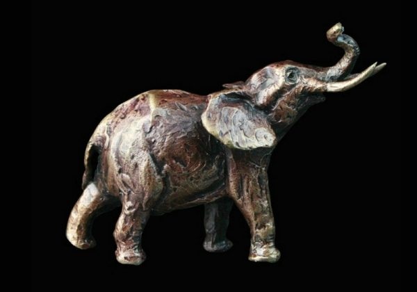 butler & peach minature bronze elephant standing with its trunk in the air