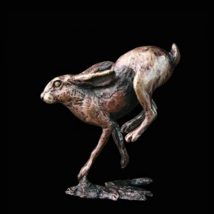 butler & peach minature bronze hare running with its back legs off the ground