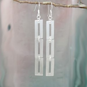 earrings made of three silver connected rectangles on hook wires