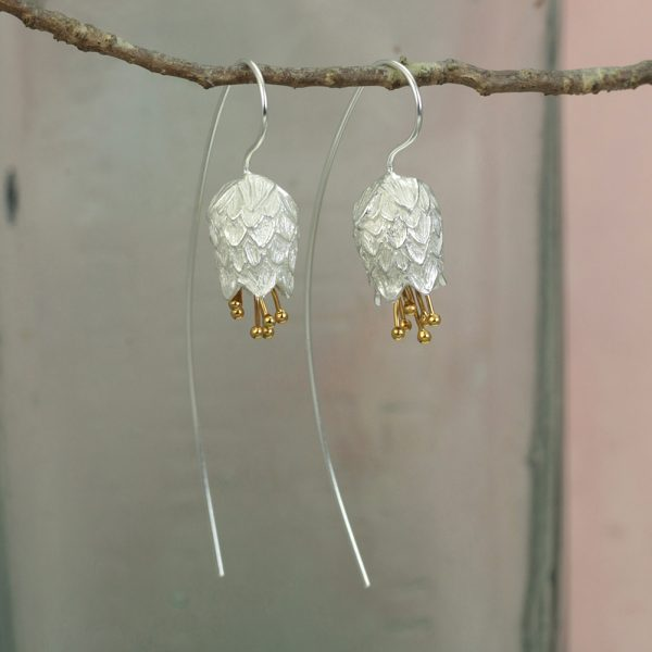 silver thistle flower earrings with gold plated stamens on very long hook wires