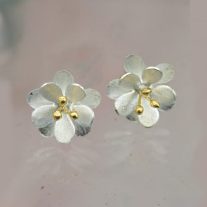 silver double layered flower stud earrings with gold plated stamens