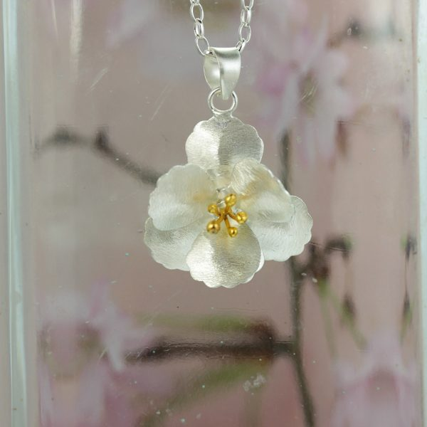 silver cherry blossom flower pendant with gold plated stamens