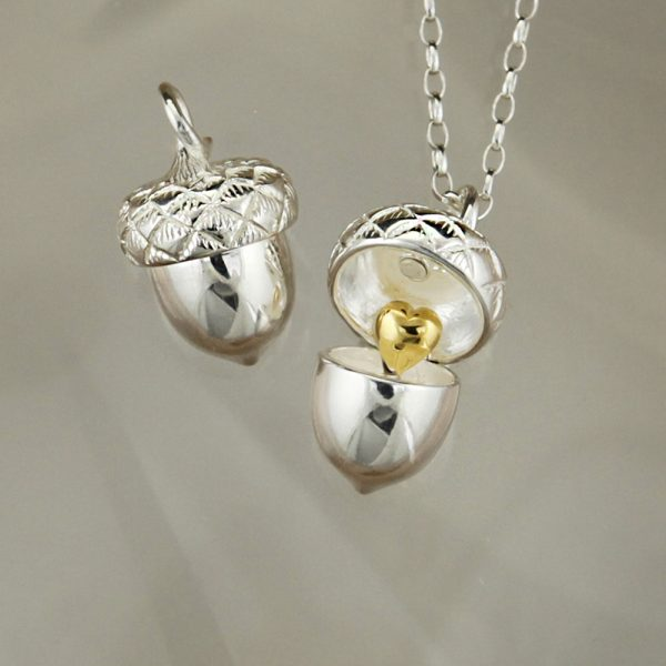 christin ranger silver acorn pendant with small gold plated heart inside