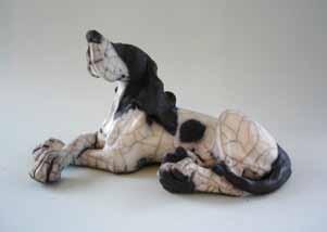 christine cummings medium laying dog