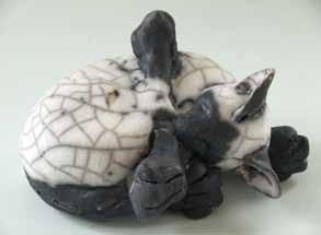 small curled ceramic cat