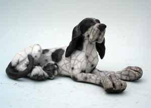 christine cummings small laying dog